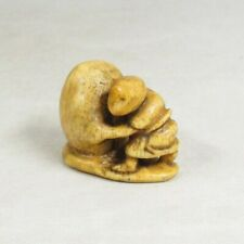 B404: Really old Japanese NETSUKE of statue of rock and man with wonderful taste