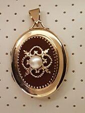 Médaillon pendentif porte photo en or 18 k 12.5 gr