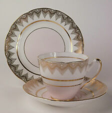 Imperial Fine English China 'Warranted 22Kt Gold'. Pink tea cup, saucer & plate