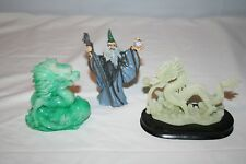 2 Dragon Figurines and 1 Wizard Figurine Holding Balls