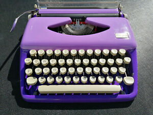 Beautiful double purple Tippa Adler portable vintage typewriter with case