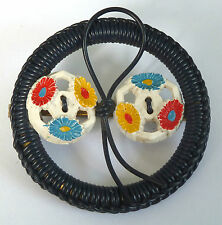A VINTAGE 1940s RED, BLACK, BLUE & YELLOW WIREWORK & BUTTON FLOWER BROOCH