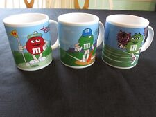 Lot of 3 M & M Coffee Mugs Red Blue Green and Yellow Sports 2002 Galerie M&M Cup