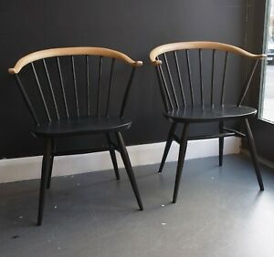 A pair of vintage 1960s Ercol black hand painted 'cowhorn' windsor chairs