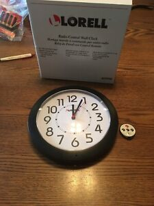 """Lorell 9"""" Radio Controlled Profile Wall Clock, Black WHITE FACE 60990 NEW WORKS"""