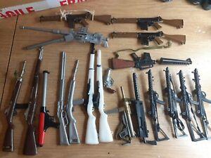 A bundle of vintage Action Man Rifles guns  weapons etc