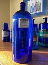 Antique cobalt blue druggist bottle controlled substance label