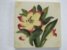 ANTIQUE RELIEF MOULDED AND HAND TINTED TILE - YELLOW / RED LILY ON CREAM