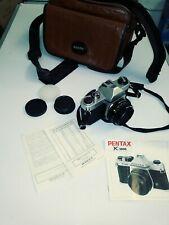 Pentax K1000 35mm SLR Camera Kit w/ 50mm Lens .Good leather case ,book