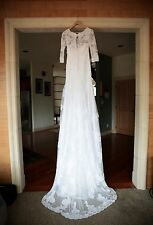 A modest handmade, 3/4 sleeve, lace wedding gown size 2. WITH VEIL