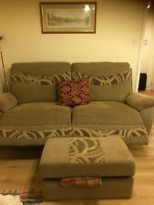 Large reclining sofa and matching footstool.