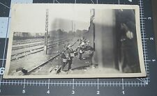 WWI Boys Sell to Soldiers on Train Men Army Street Rats Vintage Snapshot PHOTO