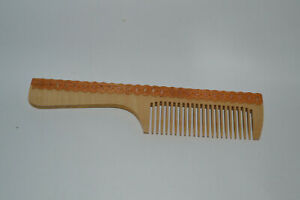 Carved comb made of wood and birch bark
