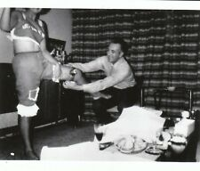 vintage abstract photo man put garter on out of frame woman leg