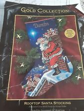 Dimensions Christmas stocking kit, Gold Collection. Roof top Santa. 8528 started