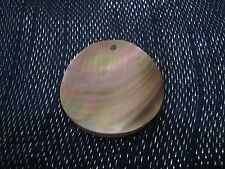 of pearl style disc approx 1¾ ins Great pendant of clear plastic with mother