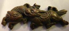 Japanese Bronze Kirin Menuki, 17th 18th c. Two horned beast playing. 45.5mm