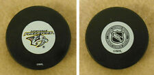 LOT OF 2 HOCKEY PUCKS -NHL OFFICIAL IN GLAS CO - NASHVILLE PREDATORS - FREE SHIP