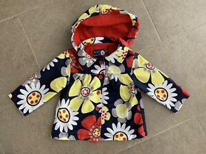 GIRL's BABY RAINCOAT FLORAL FULLY LINED HOODED AGE 6 - 9 MONTHS TU VGC