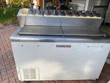 Kelvinator syrup and ice cream topping station with cooling freezer.