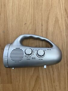 Portable Compact 3 In One Handheld Torch Radio And Siren. Battery Powered
