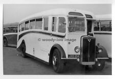 tm3896 - Black & White Coach Bus - JXD 214 - photograph