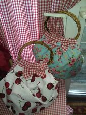 Handmade retro bags with bamboo handles Plenty of room for girlie essentials.