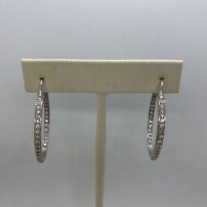 Designer 18k white gold diamond inside out hoop earrings 11.4g signed 1.05ctw