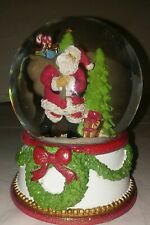 Musical Christmas Snow Globe Santa plays jingle bells