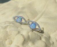 Ohrring Ohrstecker Silber 925 Auge runder blauer Opal Feueropal weiße Kristalle