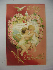 VINTAGE EMBOSSED VALENTINE'S POSTCARD CUPIDS HUGGING IN A PORTRAIT OF ROSES