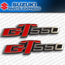 NEW 1972 - 1977 SUZUKI GT550 GT 550 INDY OEM SIDE COVER EMBLEMS PAIR 68141-34000
