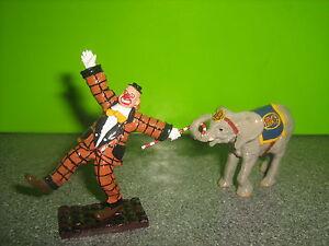 Britain's Circus 08674 Parade clown & Baby Elephant