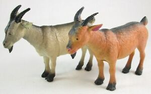 Pair of TWO Rubber Goat Figurines, 1 Beige & Black, 1 Orangey Red & Black