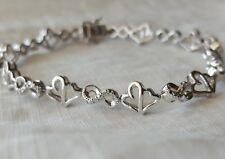 Jane Seymour Women's Diamond Infinity Hearts Sterling Silver Bracelet 7.5 Inches
