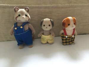 Sylvanian families  Chiffon  pup and 2 other figures with clothes