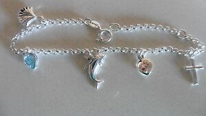 new sterling silver charm bracelet heart zirc stones , dolphin, cross ,shell