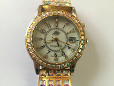 """Kirks Follet Gold and Silver """"Unforgetable"""" watch"""