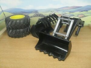 BRUDER TOYS SPARE TIRES AND EXCAVATOR BLADES AND ARM PRE-LOVED