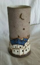 Southwest ceramic candle holder-blue mountains-adobes-stars & moon cut out-gold
