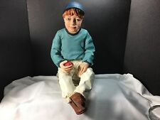 BOY WITH APPLE FIGURINE IN HAND STATUE LARGE SITTING ON STONES BASEBALL CAP CUTE