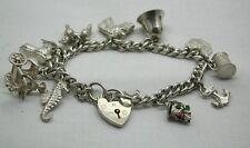 Heavy Silver Curb Link Charm Bracelet With Heart Padlock And Ten Charms