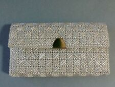 A Nice Pre-Owned Silver Colored Clutch Purse