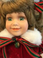Porcelain Christmas Doll with brown curly hair