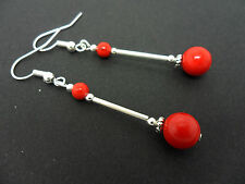 A PAIR OF DANGLY RED CORAL BEAD  SILVER PLATED DROP EARRINGS.