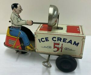 COURTLAND TIN LITHO WIND UP ICE CREAM SCOOTER