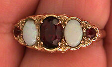 A FINE VINTAGE 9K YELLOW GOLD RING SET WITH OPALS AND GARNETS STONES-SIZE 8 5/8