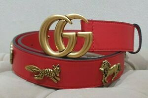 Gucci  red belt with golden tone creatures