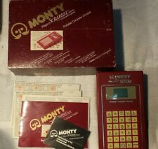 (1983) MONTY PLAYS SCRABBLE PORTABLE COMPUTER CONSOLE GAME - COMPLETE & WORKS