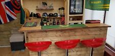 Home bar / Man cave pub with solid hardwood top counter.